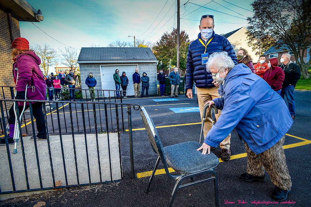 Marcie Straka, 86, of Hellertown struggles to stand as she arrives to vote. Voters line up to vote in the 2020 general election at Lower Saucon UCC in Hellertown on November 3, 2020.