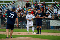 KELOWNA, CANADA - JUNE 28: NHL Montreal Canadiens player Brendan Gallagher stands safe at first base aside retired NHL player Todd Simpson during the opening charity game of the Home Base Slo-Pitch Tournament fundraiser for the Kelowna General Hospital Foundation JoeAnna's House on June 28, 2019 at Elk's Stadium in Kelowna, British Columbia, Canada.  (Photo by Marissa Baecker/Shoot the Breeze)