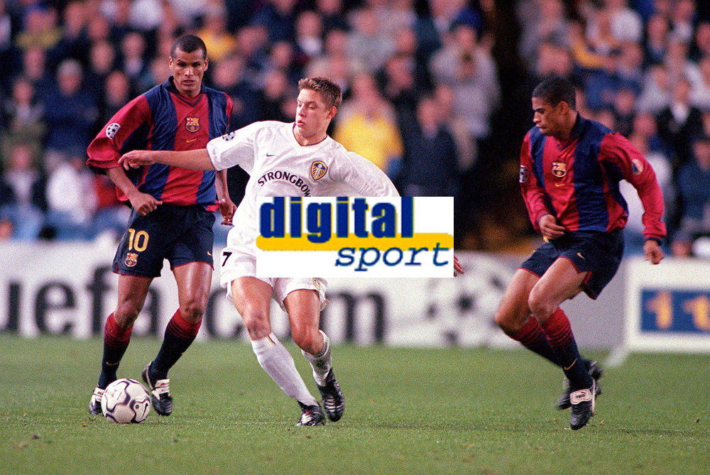 Alan Smith (Leeds) takes on Rivaldo and Michael Reiziger (Barcelona). Leeds United v Barcelona. European Champions League, Group H, 24/10/00. Credit: Colorsport / Andrew Cowie.