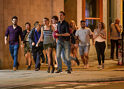 © Licensed to London News Pictures. 03/06/2017. London, UK. Members of the public flee near London Bridge after reports of an incident involving a vehicle and pedestrians.  Reports are saying a white transit van may have deliberately run down people crossing the bridge. Photo credit: Ben Cawthra/LNP