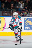 KELOWNA, CANADA - JANUARY 3: Nick Merkley #10 of Kelowna Rockets passes the puck against the Prince George Cougars on January 3, 2015 at Prospera Place in Kelowna, British Columbia, Canada.  (Photo by Marissa Baecker/Shoot the Breeze)  *** Local Caption *** Nick Merkley;