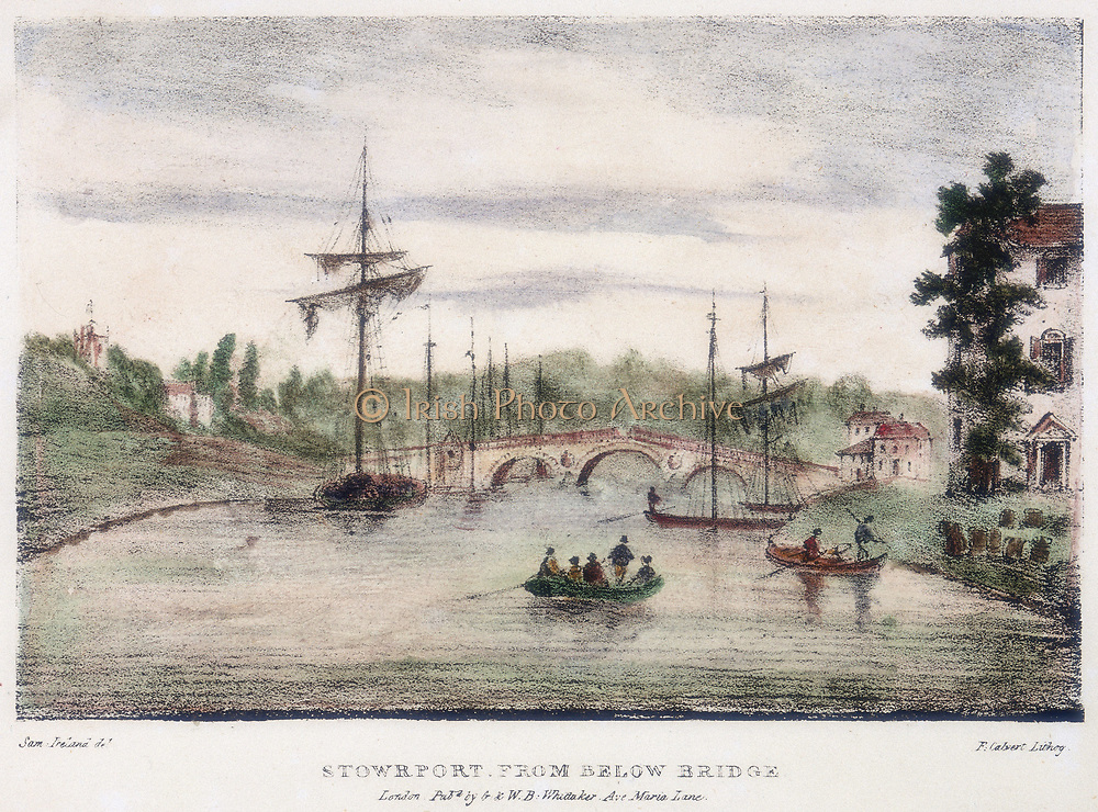 Stourport-on-Severn from below the bridge. On left is a Severn Trow which was the sailing vessel that carried cargo on the River Servern. On right are boats at the entrance of the Staffordshire and Worcester Canal, England. Illustration by Samuel Ireland (d1800)   for his 'Picturesque Views of the River Severn', (c1795). Hand-coloured. Lithograph.