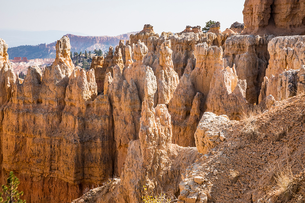 Smoke filled sky and rock stuctures called hoodoos in Bryce Canyon National Park, Utah, USA.