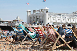 © Licensed to London News Pictures.04/05/2014. Brighton, UK. people enjoying the sunshine from the comfort of the beach chairs. Thousands of people are visiting Brighton during the May bank holiday weekend. Photo credit : Hugo Michiels. Photo credit : Hugo Michiels