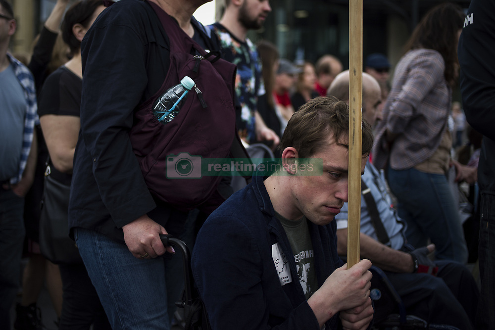 May 23, 2019 - Warsaw, Mazowieckie, Poland - A disabled protester seen on his way to the Prime Minister's office during the protest..Disabled persons and their carers protested in Warsaw. The protest was organized by RON (Parents of Disabled Children). First, outside the Presidential Palace, they read a letter to President Andrzej Duda, and later they went outside the prime minister's office. The participants of the march demand dignity, decent life, and humanitarian treatment from the government..The march was led by Iwona Hartwich, who along with her disabled son Kuba, last year occupied for 40 days the parliament's corridor to protest against the amount of alms that the state pays to people like her son. (Credit Image: © Attila Husejnow/SOPA Images via ZUMA Wire)