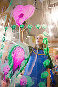 Kylie Brown, 8, of Bentonville, paints in the Art Studio at the Scott Family Amazeum on Friday, February 19, 2016, in Bentonville, Arkansas. The studio is a glass wall where children can paint and then use a squeegee to wipe away their work. Beth Hall for the New York Times