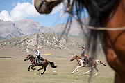 Competition at a traditional Kyrgyz horse games festival. Bosogo jailoo, Naryn province, Kyrgyzstan.
