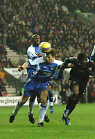 Photo: Paul Greenwood.<br />Wigan Athletic v Chelsea. The Barclays Premiership. 23/12/2006. Chelesa's Salomon Kalou, right, heads into the net past Wigan's Kevin Kilbane.