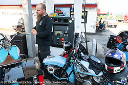 Kyle Rose of Motorcycle Legends in Utah at a gas stop during the Cross Country Chase motorcycle endurance run from Sault Sainte Marie, MI to Key West, FL. (for vintage bikes from 1930-1948). Stage-6 from Chattanooga, TN to Macon, GA USA covered 258 miles. Wednesday, September 11, 2019. Photography ©2019 Michael Lichter.