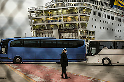 Buses wait to transfer passengers who are not infected by the COVID-19, from the Greek ferry El Venizelos to hotels in Athens to pursue the quarantine, on April 3, 2020, in the port of Piraeus near Athens. - The Greek cruise ship was placed in quarantine near Athens with 383 people on board after about 20 passengers tested positive for COVID-19, police said on March 31.<br /> <br /> Pictured: <br /> Dimitris Lampropoulos  | EEm date