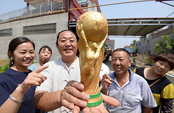 June 11, 2018 - Handan, Handan, China - Handan, CHINA-11th June 2018: The farmer Yan Junhai makes a clay sculpture of FIFA World Cup Trophy in two hours in Handan, north China's Hebei Province. (Credit Image: © SIPA Asia via ZUMA Wire)
