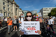 Nurses as well as care workers from St Thomas' Hospital, wearing face protective surgical masks to curb the spread of coronavirus pandemic, hold placards as they protest for a pay rise in London, Wednesday, July 29, 2020. Health care unions are launching a campaign for a pay rise for NHS (National Health Service) nurses and care workers. NHS demonstration was also supported by the Black Lives Matter activists. (VXP Photo/ Vudi Xhymshiti)