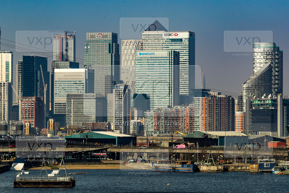 A general view of Canary Wharf financial district sky towers from the Royal Victoria Dock Bridge near Excell Center in London, Thursday, March 26, 2020. All flights from London City Airport have been cancelled as a result of the coronavirus outbreak since last night.<br /> The British Government announced Tuesday, that the ExCel Center in east London will become a 4,000-bed temporary hospital to deal with future coronavirus patients, to be called NHS Nightingale. (Photo/Vudi Xhymshiti)