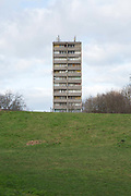 A derelict high rise building on the Aylesbury Estate captured from Burgess Park on 11th January 2017 in South London, United Kingdom. The high density estate, in the London Borough of Southwark, is currently undergoing a long-term regeneration program.