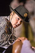 A female Drill Sergeant instructor monitors a Drill Sergeant candidate at the US Army Drill Instructors School Fort Jackson during the entry physical training test early morning September 27, 2013 in Columbia, SC. While 14 percent of the Army is women soldiers there is a shortage of female Drill Sergeants.