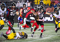 Running Back Mossis Madu Jr. (#37) jumps a tackle during the CFL match between the Ottawa RedBlacks and the Hamilton TigerCats at TD Place Stadium in Ottawa, ON. Canada on Oct. 21, 2016.<br /> <br /> PHOTO: Steve Kingsman/Freestyle Photography