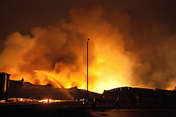 © Licensed to London News Pictures. 21/12/2011. Leyland, UK. A large fire at across several industrial units on an estate in Leyland. Photo credit : Joel Goodman/LNP