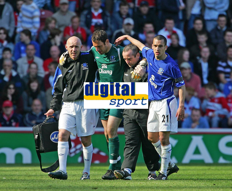 Photo: Andrew Unwin.<br />Middlesbrough v Everton. The Barclays Premiership. 29/04/2006.<br />Everton's goalkeeper, Richard Wright, limps off the field, assisted by the medical staff.