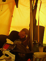Man reading in the tent