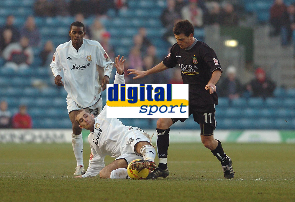 Fotball<br /> Foto: SBI/Digitalsport<br /> NORWAY ONLY<br /> <br /> MK Dons v Wrexham <br /> Coca Cola league One. 11/12/2004.<br /> <br /> MK Dons Paul Mitchell tackles Wrexhams Chris Llewellyn