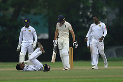 October 31, 2018 - Colombo, Sri Lanka - England cricketer Jos Buttler looks on as  Sri Lankan cricketer Pathum Nissanka falls down after being struck on the head while fielding at short leg during tour match against England cricket team at NCC ground, Colombo, Sri Lanka. 10-31-2018  (Credit Image: © Tharaka Basnayaka/NurPhoto via ZUMA Press)
