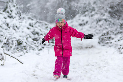 © Licensed to London News Pictures. 14/01/2021. Leeds UK. 5 year old Scarlet plays in the snow today at Primrose Valley park in Leeds after heavy snowfall in Yorkshire. Photo credit: Andrew McCaren/LNP