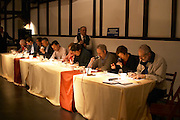The wine tasting panel with international wine judges on the podium. Montevideo, Uruguay, South America
