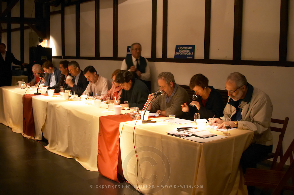 The wine tasting panel with international wine judges on the podium. Montevideo, Uruguay, South America