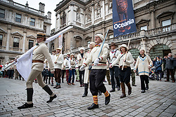 "© Licensed to London News Pictures. 09/11/2018. London, UK.  To mark Remembrance Day, the ""Unshrinkables"" practice their drill in the Royal Academy of Arts Courtyard. At the outbreak of WW1 in 1914, the original members of the United Arts Rifles – a volunteer force comprised of artists from the Chelsea Arts Club – responded to a call to duty. The group didn't have uniforms, so they bought their own ""unshrinkable"" white woollen jumpers and hats, and drilled using wooden planks and broomsticks instead of guns. They paraded in the courtyard of the Royal Academy, and were given use of some of the galleries as a mess. The group has been in existence since 1914, and each Remembrance Day the members gather together to parade in the courtyard of The Royal Academy. Photo credit: Peter Macdiarmid/LNP"