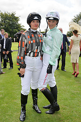 Left to right, MAGGIE BUGGIE and LEONORA SMEE at the 2014 Glorious Goodwood Racing Festival at Goodwood racecourse, West Sussex on 31st July 2014.