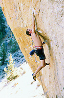 Male rock climber climbing rock face at Smith Rock State Park Oregon USA