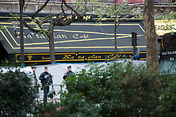 © London News Pictures. 14/11/2015. A police officer guarding Bataclan theatre the day after multiple terror attacks on the French capital. Photo credit: Guilhem Baker/LNP