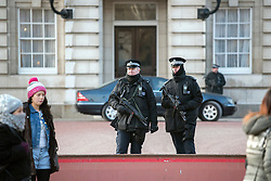 © Licensed to London News Pictures. 22/01/2015. London, UK. Armed Police officers in the grounds of Buckingham Palace during The Changing of the Guard.  Armed police officers in and around central London today 22 January 2015. UK Foreign Secretary Philip Hammond said that ISIS is the greatest threat to the UK's security at the moment. Photo credit : Stephen Simpson/LNP