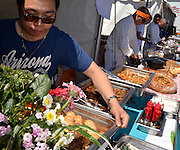 The Viva La Local Food Festival promotes local foods, Tucson, Arizona, USA.  Staff from Snow Peas Modern Asian Kitchen participate in the event.