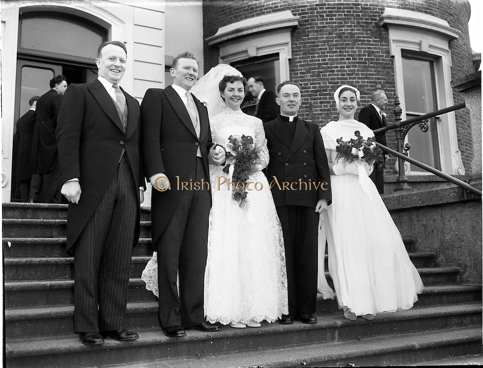 18/02/1957<br /> 02/18/1957<br /> 18 February 1957<br /> Wedding Dr K. Murphy and J. Fitzgerald at St. Mary's Church, Haddington Road and reception at Salthill Hotel, Monkstown. Bride and Groom  and Bridesmaid and Bestman  with priest outside the hotel..