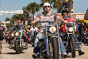 Bikers cruises down Main Street during the 74th Annual Daytona Bike Week March 8, 2015 in Daytona Beach, Florida. More than 500,000 bikers and spectators gather for the week long event, the largest motorcycle rally in America.