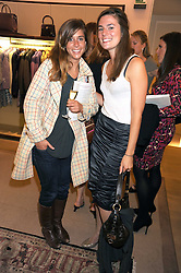 Left to right, CATHERINE FIEDEROWICZ and ASHLEY SANDS at a party to celebrate the publication of Shop Your Closet - the ultimate guide to organisingyour closet with style by Melanie Charlton-Fascitelli held at Asprey, New Bond Street, London on 16th September 2008.