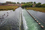 Tertiary-treated recycled water from the San Jose Creek Water Reclamation Plant is diverted to the unlined San Gabriel River for infiltration into the groundwater aquifers below. San Gabriel Spreading Grounds, Water Replenishment District – WRD, Pico Rivera, Los Angeles County