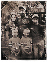 """I had visions of Diane Arbus' iconic identical twins photograph when I passed by Cameron (right) and Dalton with their family at the Waldo Flea Market. Their stepfather Brian Langford, 43, said he and the family, including wife Dana, 27, and son Dillon, 11, where just """"killing the day"""" looking at the odds and ends for sale."""