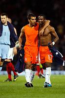 Football<br /> 09/09/2009 SCOTLAND V NETHERLANDS: <br /> GIOVANNI VAN BRONCKHORST AND GOAL SCORER EIJERO ELIA  DURING THE 2010 WORLD CUP QUALIFIER AT HAMPDEN PARK, GLASGOW.<br /> CREDIT: COLORSPORT