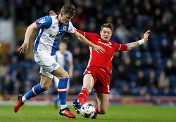 Blackburn Rovers' Sam Gallagher battles for the ball with Cardiff City's Greg Halford