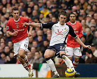 Photo: Leigh Quinnell.<br /> Tottenham Hotspur v Charlton Athletic. The Barclays Premiership. 05/02/2006. Tottenhams Michael Carrick crosses the ball watched by Charltons Darren Ambrose.