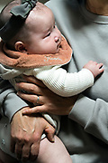 Japanese baby toddler held by grandmother