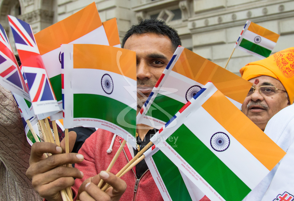 Whitehall, London, November 12th 2015. Demonstrations take place outside the gates of Downing Street ahead of the arrival of India's Prime Minister Narendra Modi. Nepalese citizens protest against what they say is a blockade of their country by India whilst other groups opposed to Modi shout their anger, trying to drown out a smaller group welcoming the controversial leader to Britain.