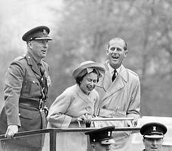 May 11, 1963 - Cwrt-y-Gollen, Wales, U.K. - The elder daughter of King George VI and Queen Elizabeth, ELIZABETH WINDSOR (named Elizabeth II) became Queen at the age of 25, and has reigned through more than five decades of enormous social change and development. PICTURED: QUEEN ELIZABETH and PRINCE PHILIP watching a funny presentation by recruits of Welsh Brigade.  (Credit Image: © Keystone Press Agency/Keystone USA via ZUMAPRESS.com)