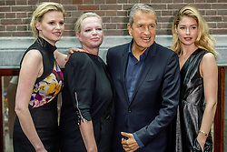 File photo : Mario Testino, Karin Swerink, Lara Stone and Doutzen Kroes during the presentation of the anniversary issue of Vogue Netherlands in Amsterdam, Netherlands, on March 8, 2017. The magazine has five years and is celebrating with a special edition with the top of the Dutch fashion and modeling world. Photographer to the stars Mario Testino is a favourite of the Royal Family but he is facing a stream of sexual misconduct allegations from male models. Fashion brands Burberry and Michael Kors moved quickly to cut ties with him. He had been a front-runner to be the official photographer at the wedding of Prince Harry and Meghan Markle but has been ruled out following the uproar. Photo by Robin Utrecht/ABACAPRESS.COM