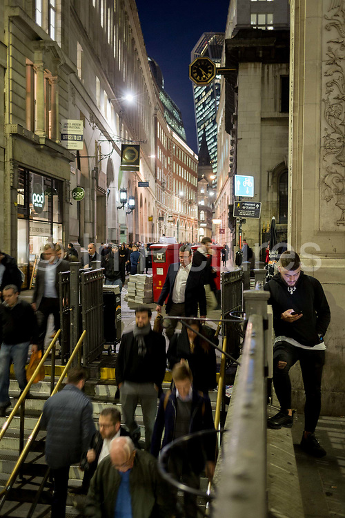 Blurred commuters enter the Underground Station entrance at Bank, on the corner of Lombard and King William Streets in the heart of the Square Mile, the capitals historical and financial centre, on 1st November 2017, in the City of London, England.