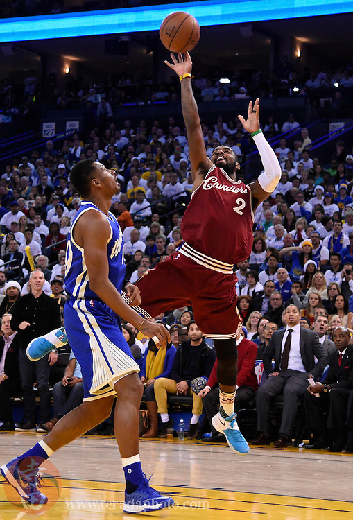 Dec 25, 2015; Oakland, CA, USA; Cleveland Cavaliers guard Kyrie Irving (2) shoots against the Golden State Warriors in the first half of a NBA basketball game on Christmas at Oracle Arena.