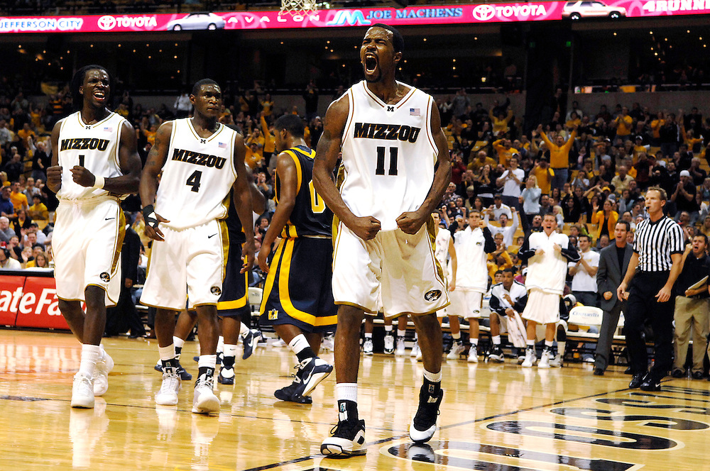 Missouri's Zaire Taylor, center, celebrates a break away basket during the Tigers' 75-64 win over Murray State.