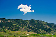 Cloud floats above landscape near Ice Cave road and highway 34, Caribou county, Idaho